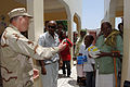 US Navy 070808-N-3931M-040 Rear Adm. James Hart, commander, Combined Joint Task Force-Horn of Africa, talks with local residents at the Assamo Medical Clinic.jpg