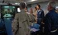 US Navy 080210-N-7179R-001 Rear Adm. Mark Balmert, commander, Expeditionary Strike Group (ESG) 3, embarked aboard the amphibious assault ship USS Tarawa (LHA 1), promotes Information Systems Technician 3rd Class Robert Young.jpg