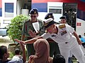 US Navy 080709-N-4431B-957 Rear Adm. Nora W. Tyson, commander of Logistics Group Western Pacific, high-fives a child at Sekolah Kebangsaan Kijal Elementary School.jpg