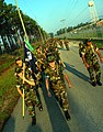US Navy 080815-N-7367K-012 Seabees assigned to Naval Mobile Construction Battalion (NMCB) 1 march along the outer limits of Naval Construction Battalion Center, Gulfport, during the battalion's three-mile force march.jpg