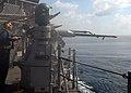 US Navy 081107-N-9900B-003 Gunner's Mate 2nd Class Michael Finch test-fires a 25mm gun aboard the guided-missile cruiser USS Monterey (CG 61).jpg