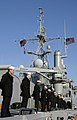 US Navy 090115-N-3316L-312 Sailors man the rails of USS Nashville (LPD 13).jpg