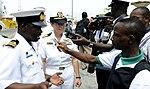 US Navy 100310-N-7948C-250 Capt. Cindy Thebaud, and Ghanaian navy Lt. Cmdr. Samuel Ayelazono speak with Ghanaian media.jpg