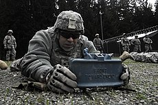 US Navy 100502-N-6538W-239 Master-at-Arms 2nd Class Miguel Irizzary, from Miami, sets up a claymore mine simulator during an Army Warrior training course.jpg