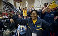 US Navy 100511-N-6932B-295 Bureau of Medicine and Surgery Force Master Chief Laura Martinez and other fans cheer for the Navy sitting volleyball team during their first preliminary game against Army at the inaugural Warrior Gam.jpg