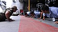 US Navy 100630-N-9643W-068 Equipment Operator 2nd Class Jeremy Hall, from Indiana, left, and Engineman 1st Class Joseph Nicholas, from New York, do pushups with sailors from the El Salvador navy.jpg