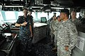 US Navy 100813-N-3283P-016 Command Master Chief Eric Cole, left, describes the duties and responsibilities of the bridge watch team to Command Sgt. Maj. Luniasolua Savusa, right,.jpg