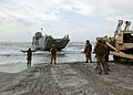 US Navy 100819-N-ZZ999-002 Sailors assigned to Beachmaster Unit (BMU) 2 and Assault Craft Unit (ACU) 2 load Marines and their equipment onto a land.jpg