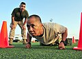 US Navy 110401-N-1755G-208 Chief Personnel Specialist Romel Agliam, right, participates in the Marine Corps Combat Fitness Test in celebration of t.jpg