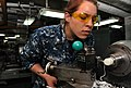 US Navy 110427-N-5031T-048 Machinery Repairman 3rd Class Chelsea Martinez fabricates a Teflon bushing in the sheet metal shop aboard USS John C. St.jpg
