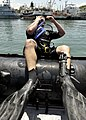 US Navy 110727-N-KB666-138 Master Seaman John Penney enters the water to conduct search operations with Mobile Diving and Salvage Unit (MDSU) 2.jpg