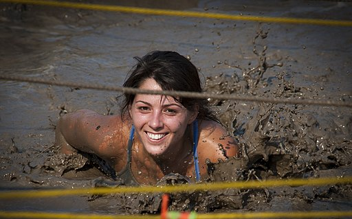 US Navy 110813-N-XS652-558 A runner navigates an obstacle during the 11th annual Armed Services YMCA Mud Run at Joint Expeditionary Base Little Cr