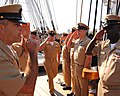 US Navy 110916-N-SH953-241 Chief Culinary Specialist Brian Pettee salutes while passing through the side boys for the first time as a chief petty o.jpg