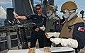 US Navy 111025-N-MW330-811 Fire Controlman 2nd Class Peter Lopez explains how to reload an M240B machine gun.jpg