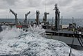 US Navy 111220-N-DX615-005 Heavy waves crash against the Military Sealift Command fleet replenishment oiler USNS Tippecanoe (T-AOE 199) during a re.jpg