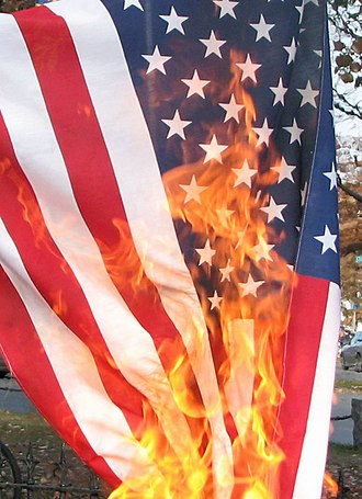 Flag of the United States - American flag being burned in protest on the eve of the 2008 election.
