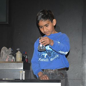 Universum (UNAM) - Child with beaker at a chemistry demonstration