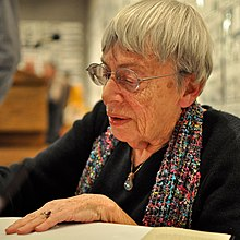 Ursula K. Le Guin signing a book in 2013