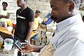 Using mobile phones to deliver aid messages after the earthquake in Haiti (7561267772).jpg