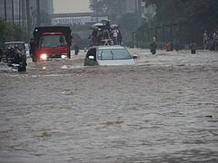 VOA A car tries to drive through Jakarta's flooded streets.jpg