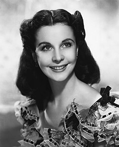 Vivien Leigh won twice for her roles as Scarlett O'Hara in Gone with the Wind (1939), by which she became the first English actress to have won the award and the first for a color movie, and Blanche DuBois in A Streetcar Named Desire (1951). Vivien Leigh Scarlet.jpg