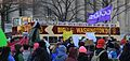 Water is life marchers with Haudenosaunee flag in front of a Washington DC tour bus.jpg