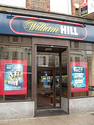Fixed odds betting terminal - Poster (on left) advertising fixed-odds betting terminals at a William Hill shop in Worthing.