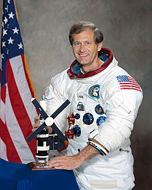 Pogue posing in his spacesuit