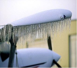 Freezing rain - Freezing ice on aircraft wing.