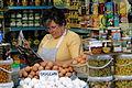 Woman Reading at Market Stall - Granada - Spain.jpg