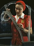 Woman worker in the Douglas Aircraft Company plant1942 edit1 (cropped).jpg