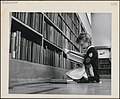 Young girl reading a book, Central Circulating Library at College and St. George Streets, Toronto, Ontario.jpg
