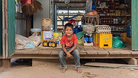 Young vendor in a grocery store in Don Som (2).jpg