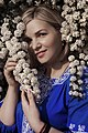День Вишиванки. Молода україночка у вишитій синій сукні серед квітів 01.jpg