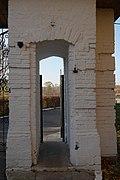 Проход в пилоне ограды церкви Тихвинской иконы Божией Матери в селе Авдотьино.jpg