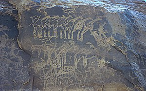 Niger - Ancient rock engraving showing herds of giraffe, ibex, and other animals in the southern Sahara near Tiguidit, Niger.