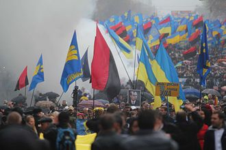 Ukrainian nationalists carry portraits of Stepan Bandera and flags of the Ukrainian Insurgent Army 2012 UPA March in Kiev.jpg