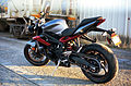2014 Triumph Street Triple R matte graphite left rear 2.JPG