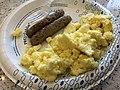 2019-09-22 08 07 13 A plate of scrambled eggs and sausage at the Hampton Inn and Suites in East Greenbush, Rensselaer County, New York.jpg