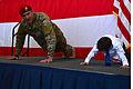 26th STS CC Maj. Michael Jensen push-ups.jpg