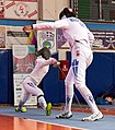 2nd Leonidas Pirgos Fencing Tournament. Pari Filippousi performs a lunge against Nefeli Rodopoulou with the intention of scoring a foot touch.jpg