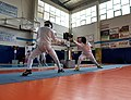 2nd Leonidas Pirgos Fencing Tournament. The fencer George Panagiotakopoulos performs an advance lunge and scores a touch.jpg