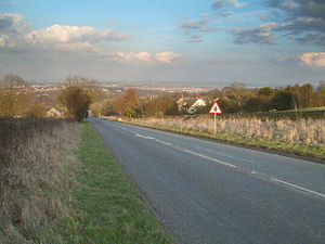 A632 road - View looking downhill towards Slatepit Dale and with Chesterfield visible in the distance.