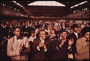 Nation of Islam - A crowd of Muslims applaud during Elijah Muhammad's annual Saviors' Day message in Chicago in 1974