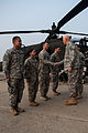A U.S. Soldier assigned to the 4th Squadron, 6th Cavalry Regiment, 16th Combat Aviation Brigade, 2nd Infantry Division shakes hands with Chief of Staff of the Army Gen. Raymond T. Odierno, right, at Camp 140224-A-KH856-449.jpg