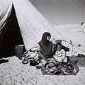 A YEMENITE WOMAN AND HER CHILD IN FRONT OF THEIR TENT AT THE EZRA UBITZARON QUARTER IN RISHON LEZION. עולים מתימן גרים באוהלים בשכונה חדשה בראשון לציוD835-105.jpg