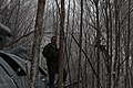 A joint military team locates debris at the site where an-MH-60S Knighthawk helicopter crashed in Pocahontas County, W.Va., Feb. 18, 2010 100218-A-GW288-080.jpg