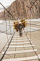 A man crossing Hussaini Suspension Bridge without any Support.jpg