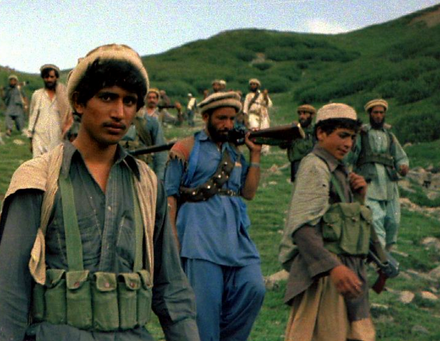 CIA-funded and ISI-trained Afghan mujahideen fighters crossing the Durand Line border to fight Soviet forces and the Soviet-backed Afghan government in 1985. Afghan Muja crossing from Saohol Sar pass in Durand border region of Pakistan, August 1985.png