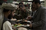 Afghan National Army Maj. Gen. Sayed Malook, center, the commanding general of the 215th Corps, gets food during a friendship dinner at the Afghan Cultural Center at Camp Leatherneck in Helmand province 130725-M-RF397-231.jpg